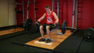 نمایش فیلم آموزش حرکات بدنسازی ساق پا نشسته با هالتر